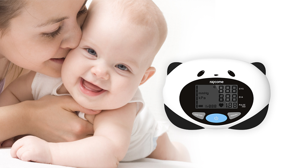 A baby and a kid use blood pressure monitor