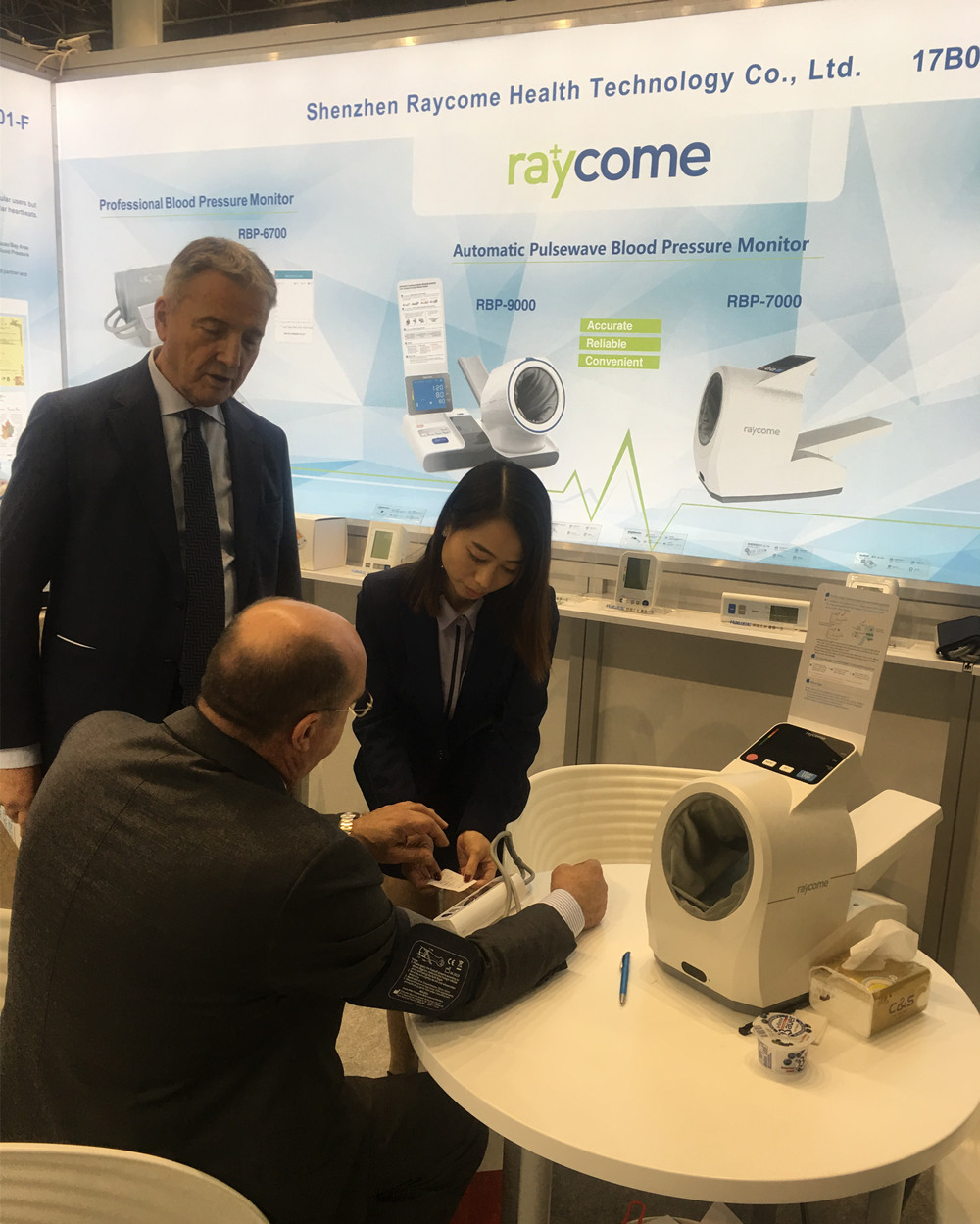 A Raycome staff showing clients how to use Raycome BP machines