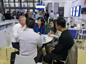 Raycome staffs talking to clients