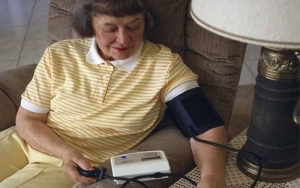 A Person Checking their Blood Pressure at Home