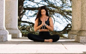 A lady in a meditative pose