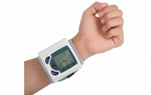 A wrist blood pressure monitor working on a person's wrist