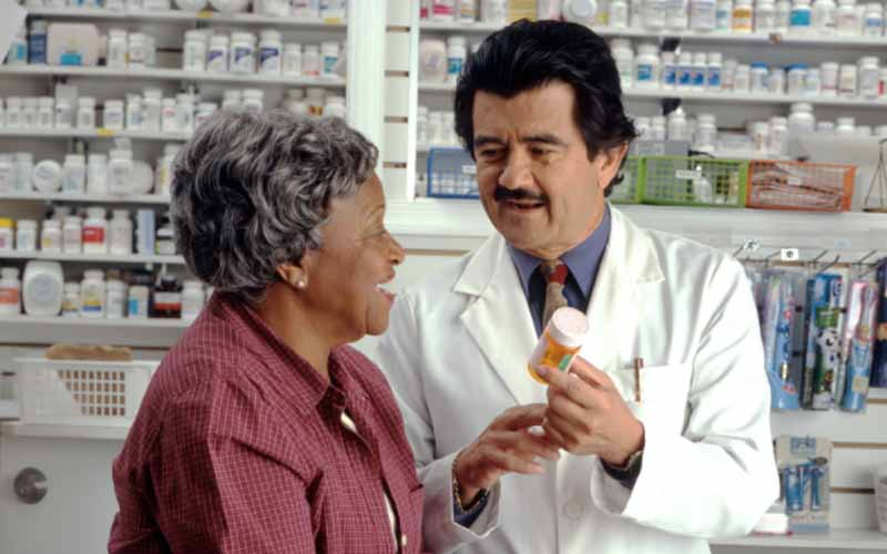 Lady consults with pharmacist