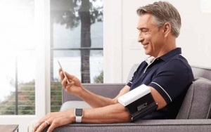 Man seated while taking blood pressure measurements