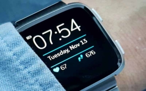 A blue smartwatch displaying time and data