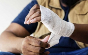 man-dressing-a-wound-on-his-hand