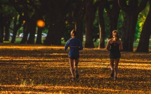 Two women running in the park